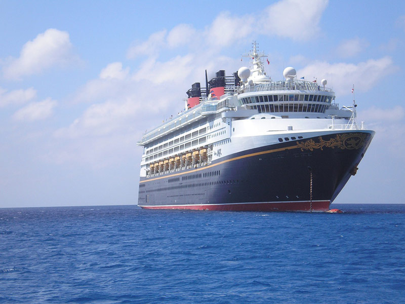 Disney Cruise sails in clear sky on the ocean