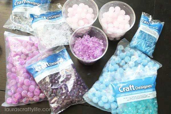Supplies for a DIY Frozen Bracelet with string and beads