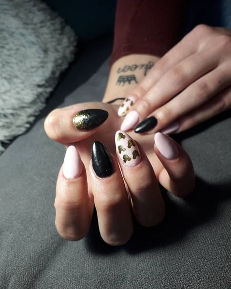 "If you're the type to wear sequin mouse ears to the park, then these glam nails are perfect for you! Go with oh-so pretty black and a marshmellow-y pink, then add glittery gold accents. Then take it up an ""extra"" notch by making them a luxe almond shape."
