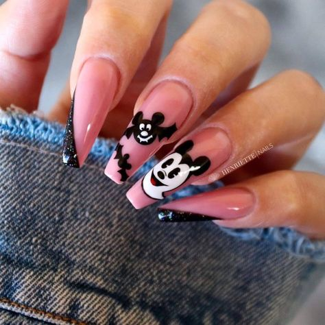 Long, coffin nails channel Halloween and Disney villains. Add some fun vibes by painting on a ghost and bat Mickey. Then get ready to dance at the Oogie Boogie Bash with these spooooky nails!