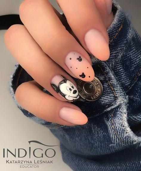 Let the mouse become the focal point on your fingertips. Keep the rest of the nails a simple nude matte. Then go to town on the middle finger and ring finger.
