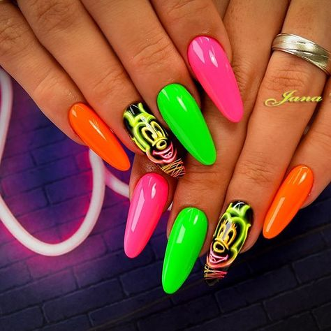 Feeling bold? These neon Mickey Mouse nails will stop traffic!