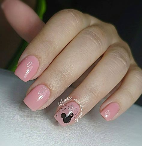 Millennial pink meets Mickey Mouse on these short, square-shaped fingernails.