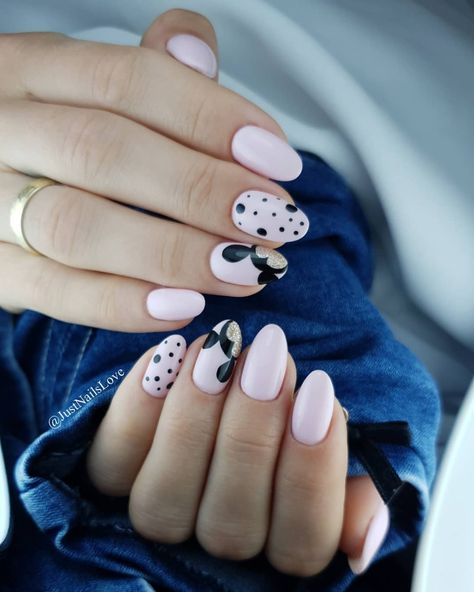 What makes these Mickey Mouse nails very girly and modern? Baby pink, rounded nails, and a hint of gold shimmer on black accents.