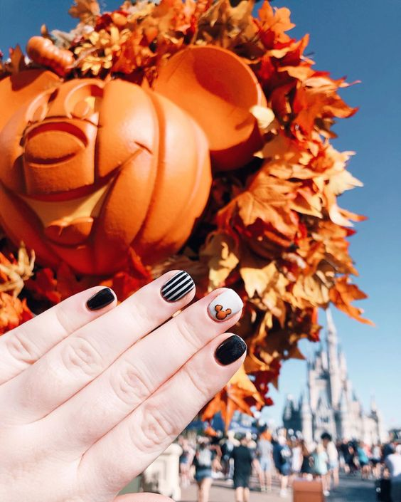 "This ""not-so-scary"" nail art is perfect to try at home. This simple, short look guarantees no nail breakage at Mickey's Halloween Party."