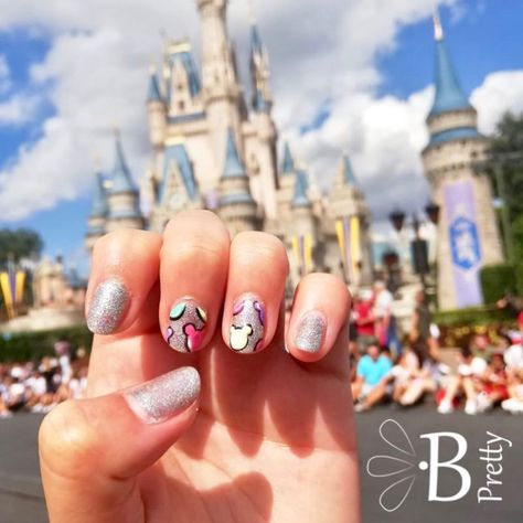 Make your nails as happy as the happiest place on earth! Colorful, pastel mouse ears on silver shimmer will add an extra pep in your step.