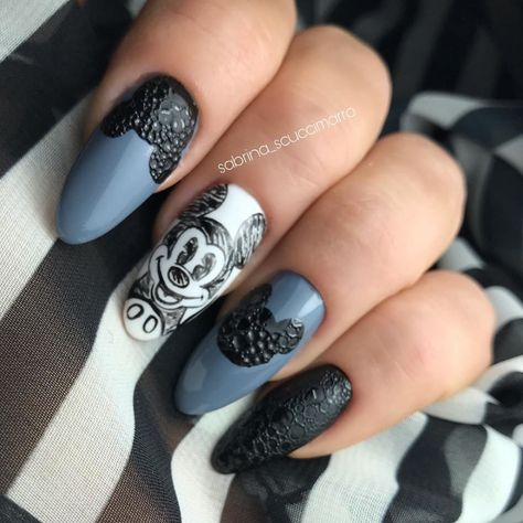 Blue, Black, and white acrylic nails with Mickey Mouse stencil on the design.