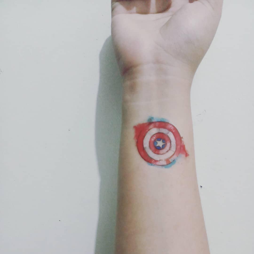 small Captain America shield tattoo