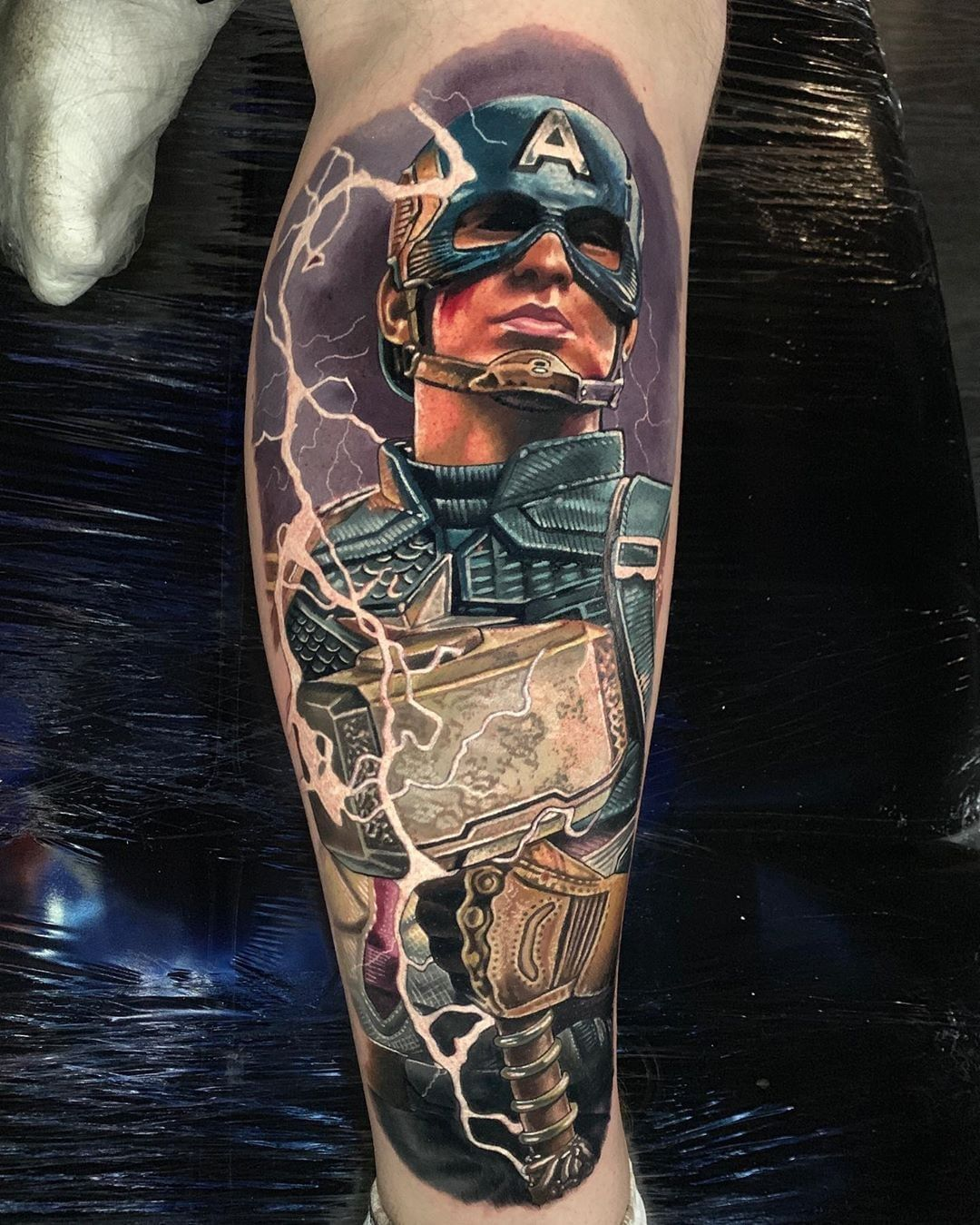 Captain America with Thor's hammer tattoo