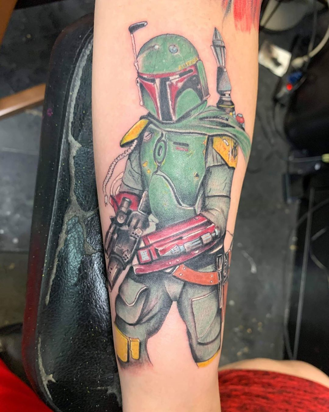 Boba Fett standing with gun tattoo