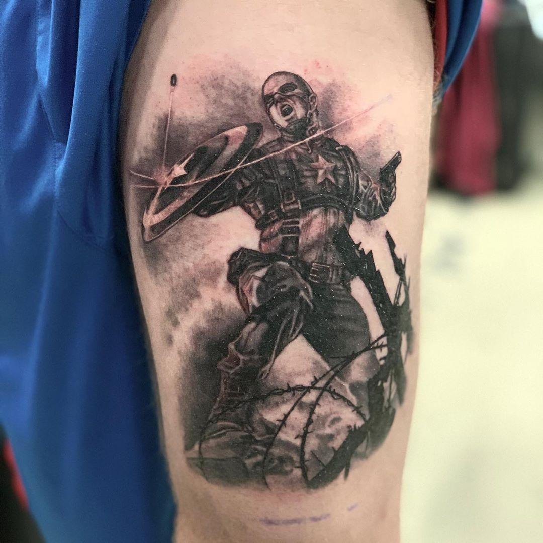 Captain America deflecting bullet tattoo