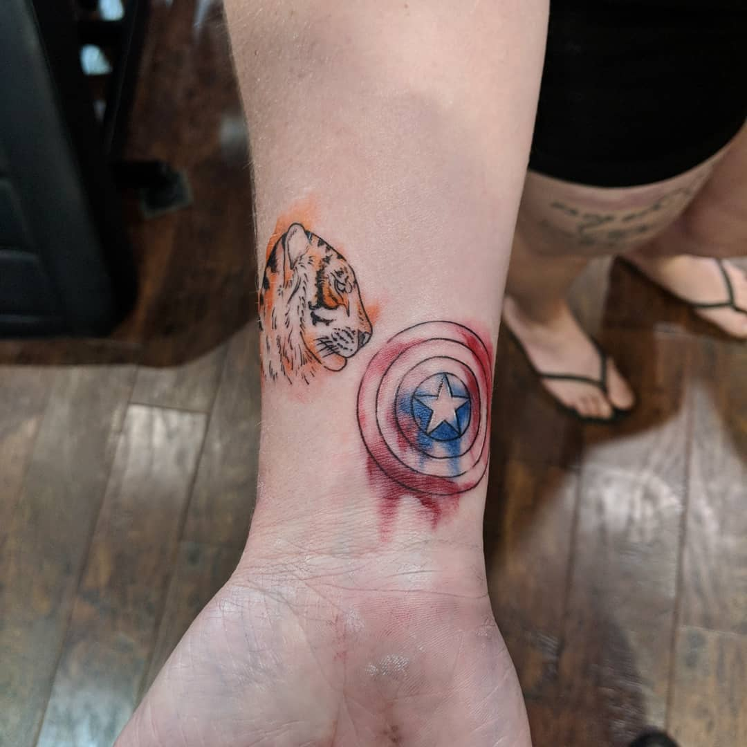 tiger and Captain America's shield tattoo
