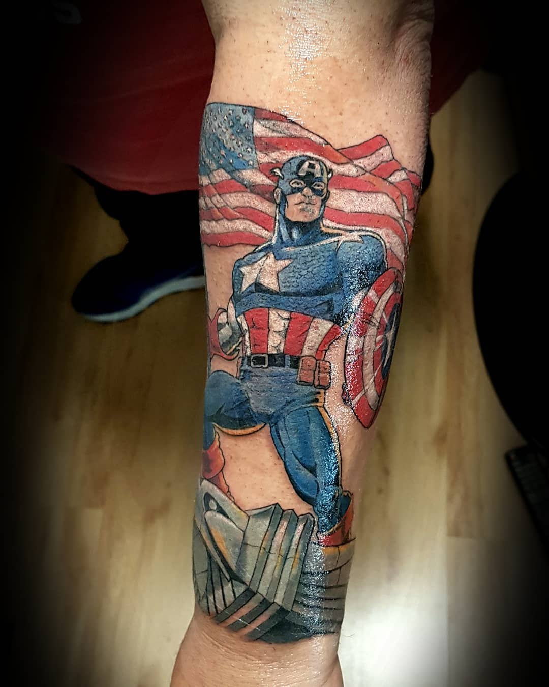 Captain America with American flag tattoo