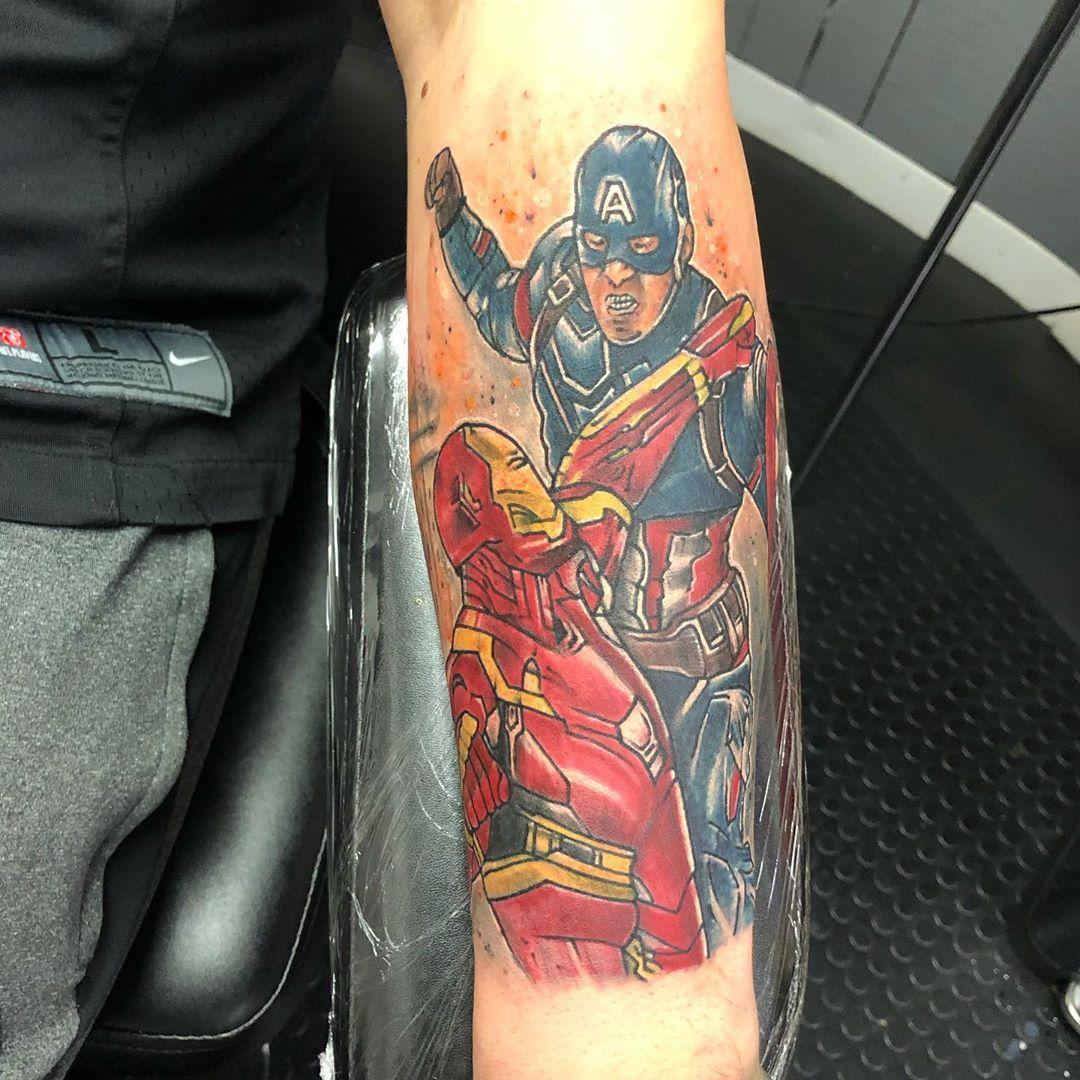 Captain America fighting Iron Man tattoo