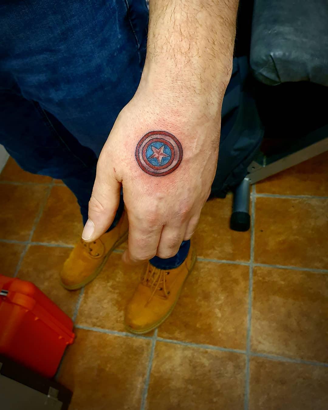 Captain America's shield on hand tattoo