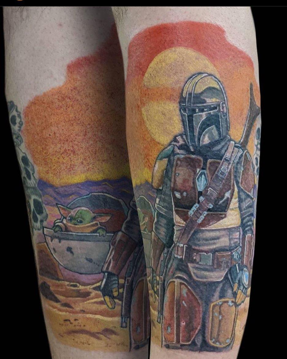 dual matching Mandalorian and baby Yoda tattoos