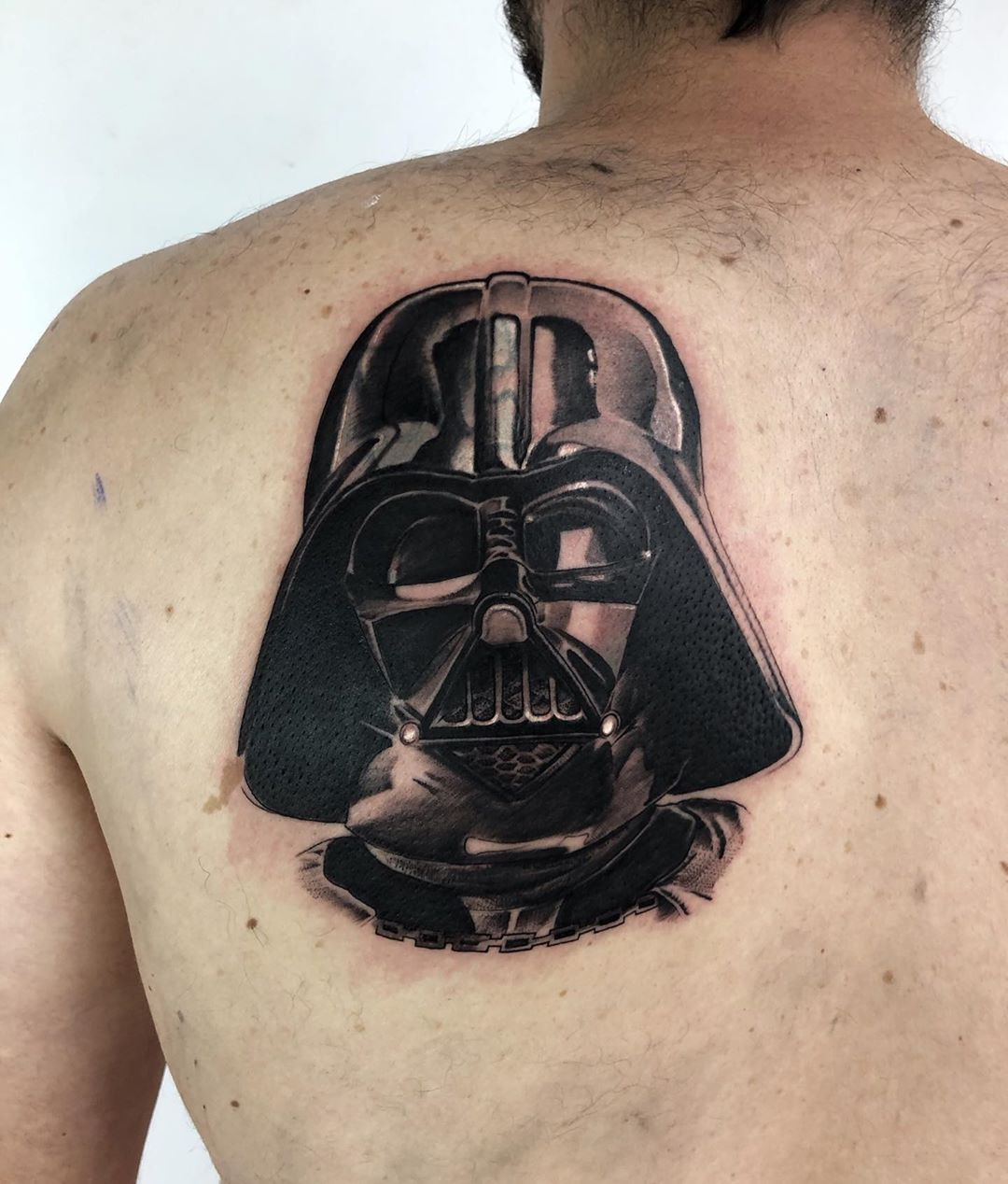 Vader mask tattoo on the back