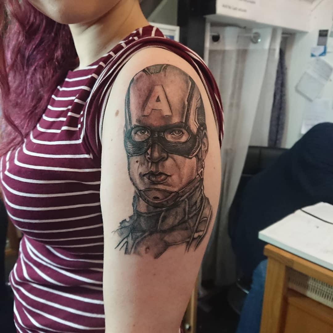 Captain America black and white head tattoo