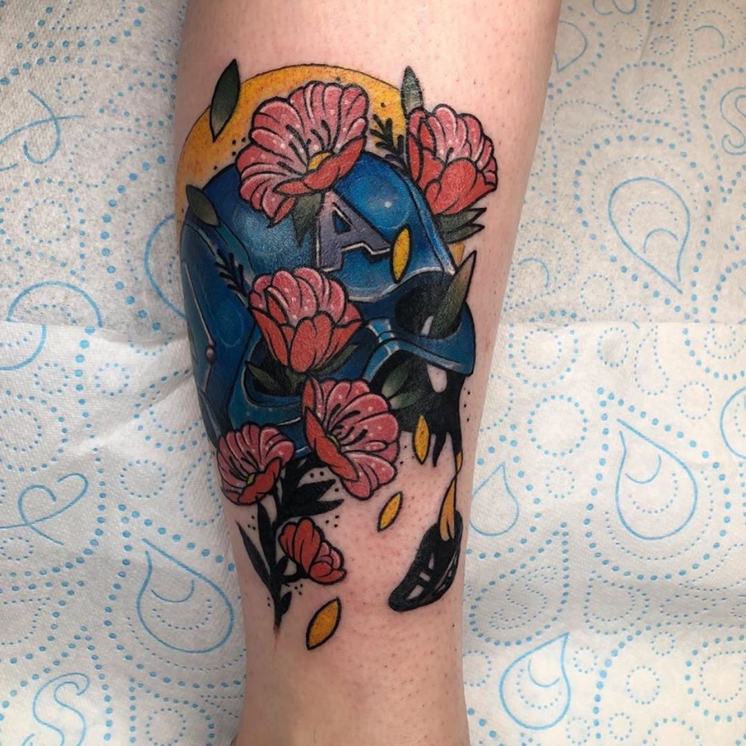 Captain America's helmet and flowers tattoo