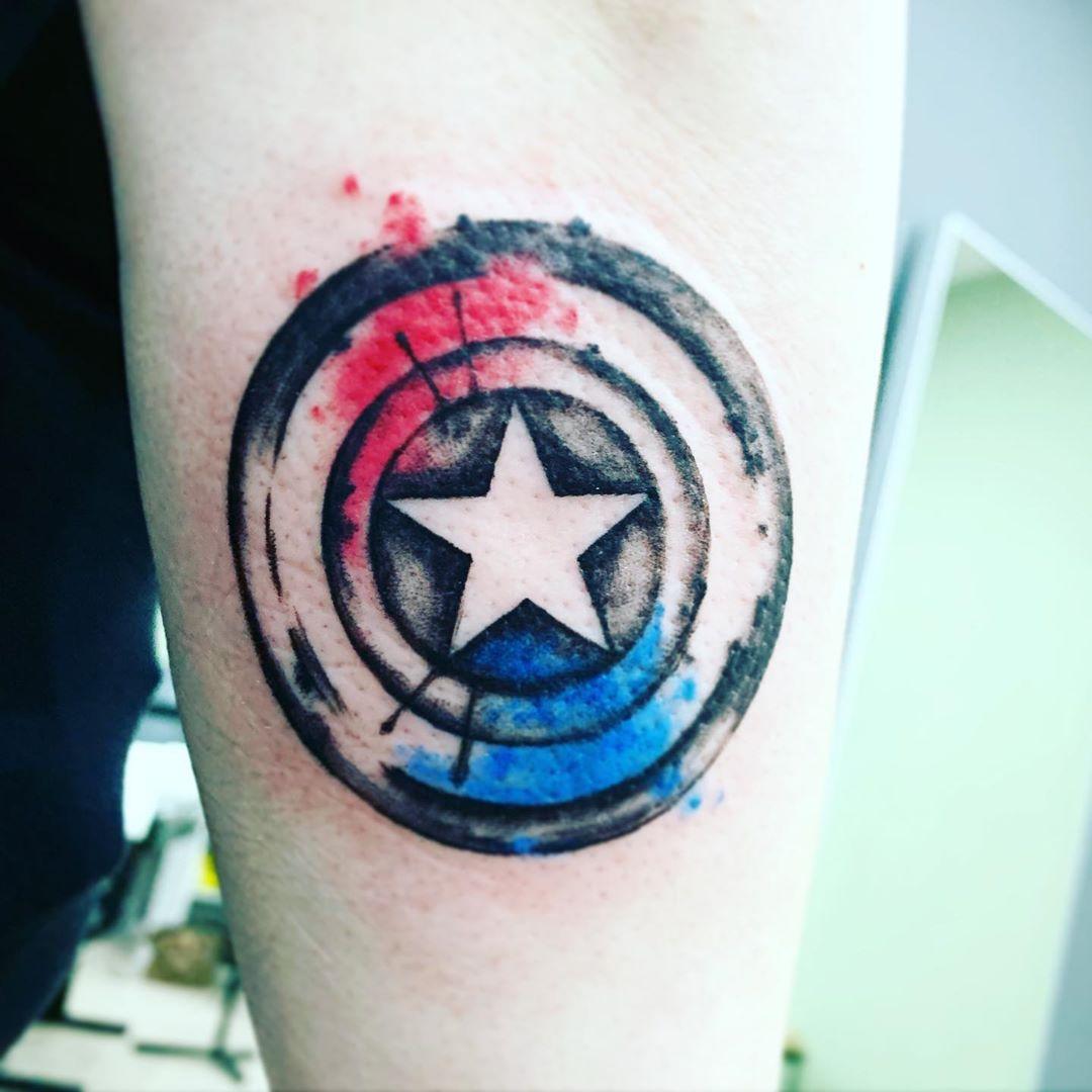 Captain America's shield splash of color tattoo