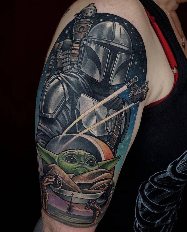 Mandalorian with spaceship and baby Yoda tattoo