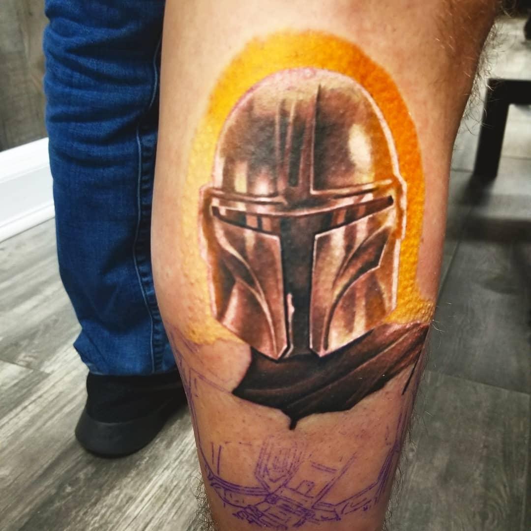 Mandalorian with halo tattoo