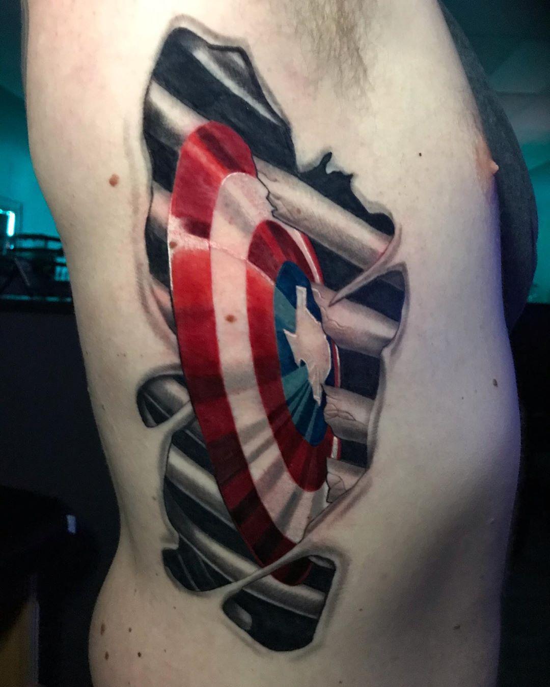 Captain America's shield in ribcage tattoo