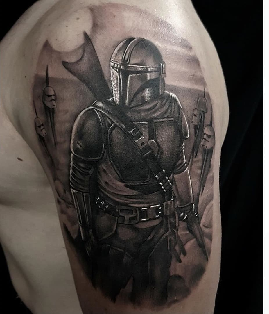 Mandalorian surrounded by stormtrooper helmets tattoo
