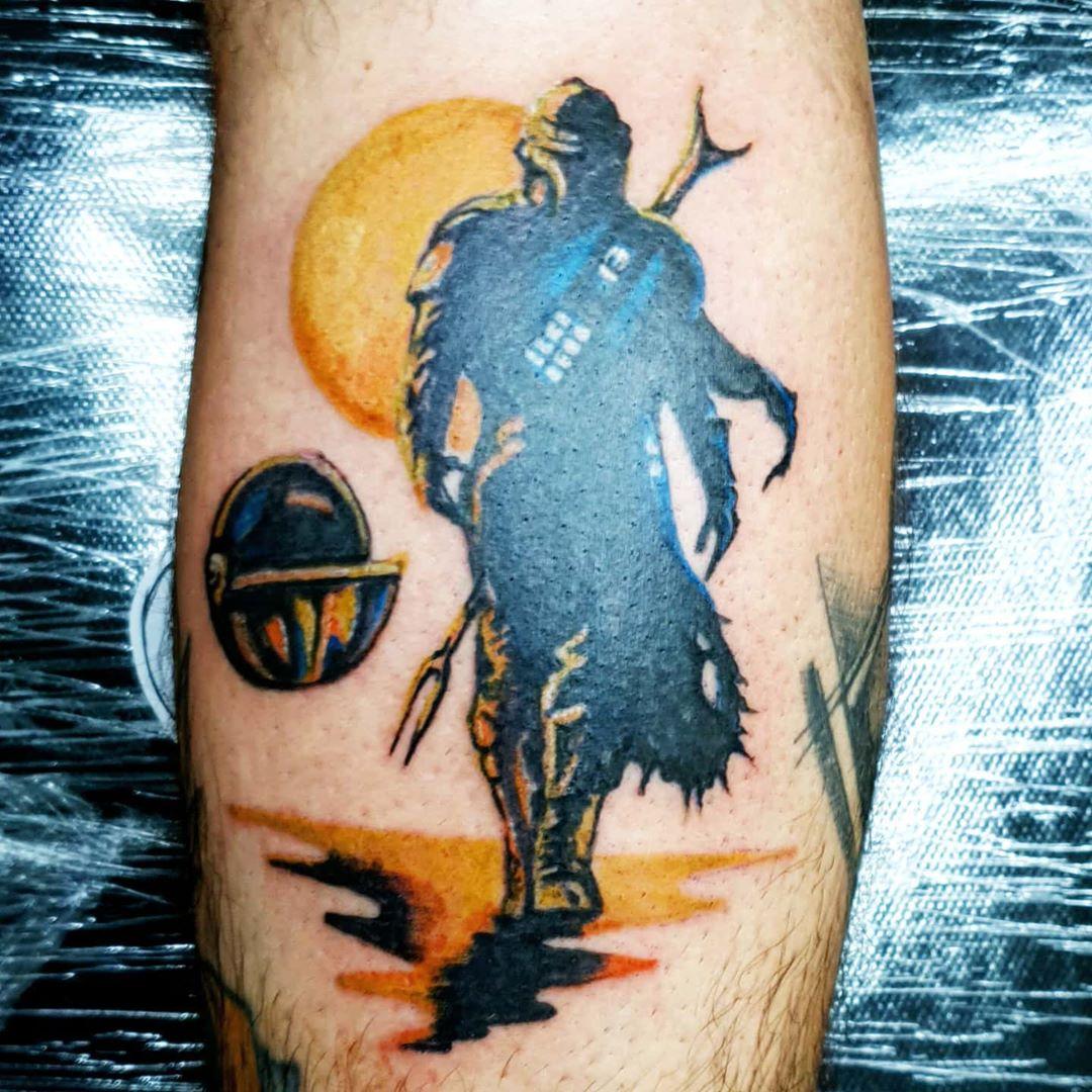 Mandalorian with setting sun tattoo