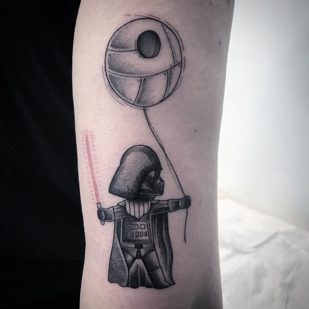 Baby Vader and a balloon that looks like Death Star
