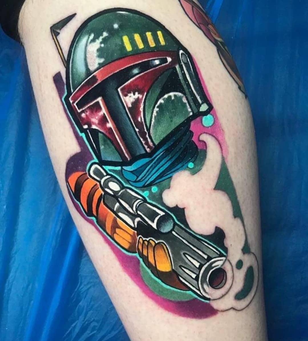 technicolor Mandalorian with gun tattoo