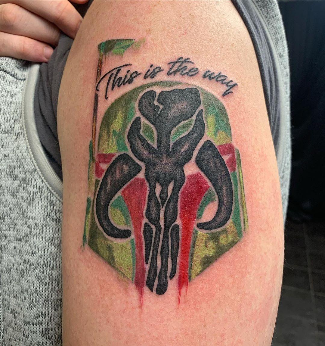 Mandalorian insignia on Boba Fett's helmet tattoo