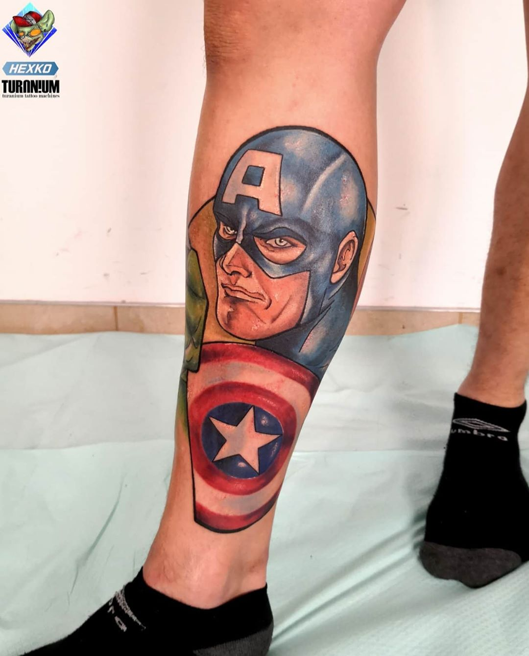 Captain America calf tattoo