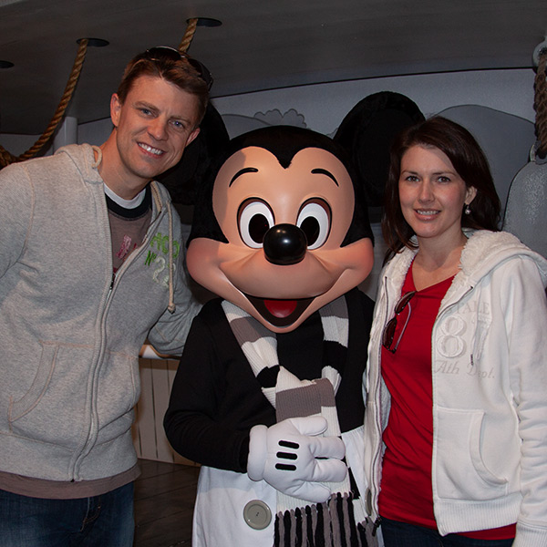 man and woman with mickey mouse