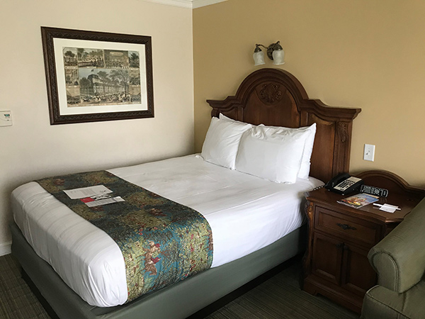 hotel room with bed and nightstand