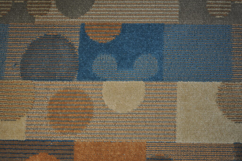 Hidden Mickeys in the old carpet at Pop Century resort in Disney World.
