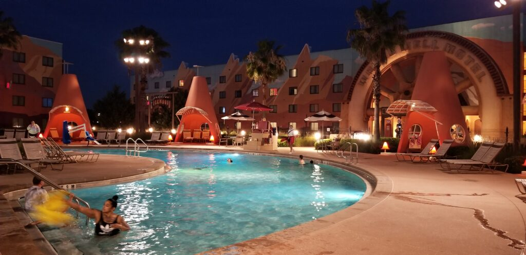 Night at pool area at Art of Animation resort